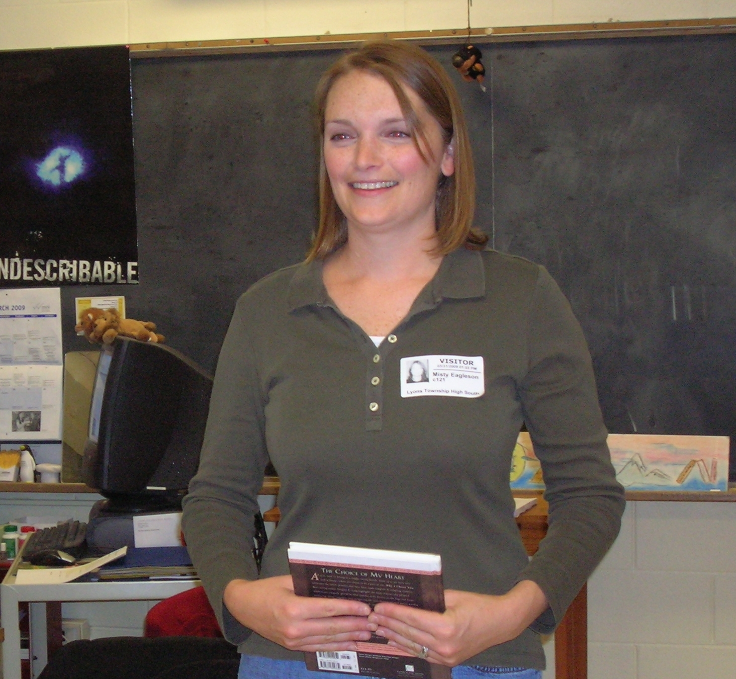 Cradle volunteer speaking at a classroom
